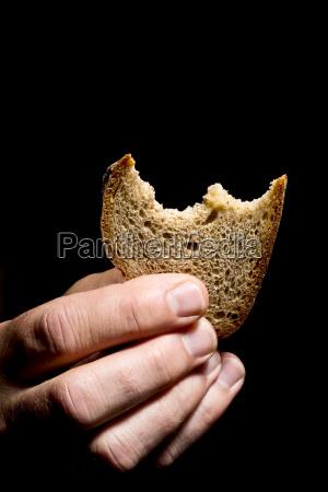 mature man holding bread close up