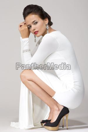 woman wearing white gown studio shot