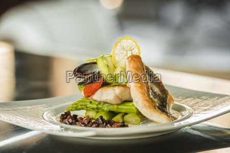 plate of sea bass with green