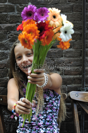 netherlands girl holding flowers in front