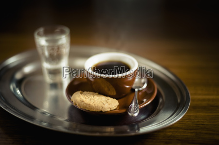 espresso black coffee with cookie and