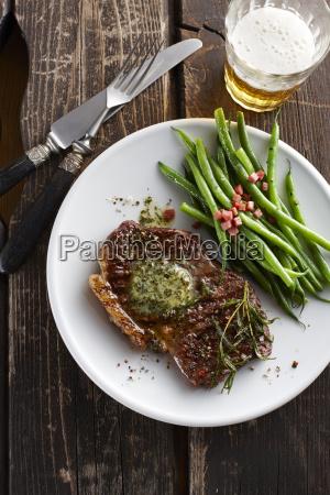 rump steak with herbed butter green