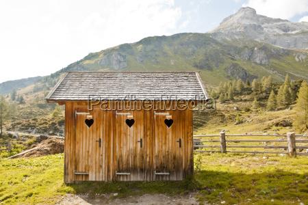austria lungau outhouses in alpine landscape