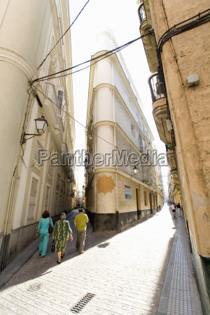 spain andalusia people walking through calle