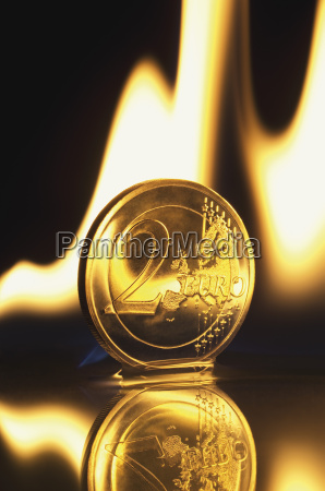 two euro coin burning