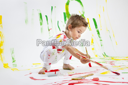 toddler having fun with paint
