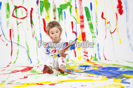 toddler with paint brushes