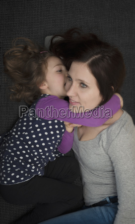 young mother cuddling with her little