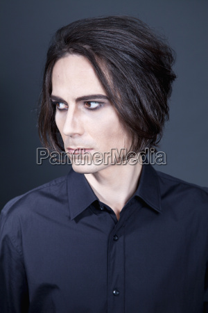 man with make up looking away