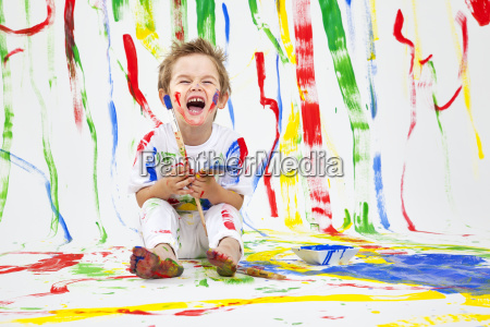 toddler, having, fun, with, green, paint - 21102371