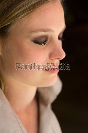 blond woman eyes closed
