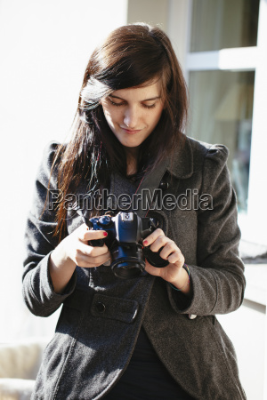young woman looking at her digital