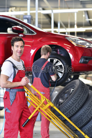 car mechanic in a workshop changing