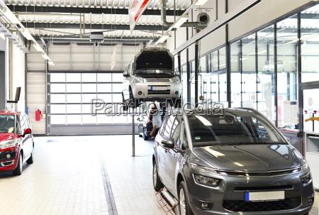 vehicles in modern automotive workshop