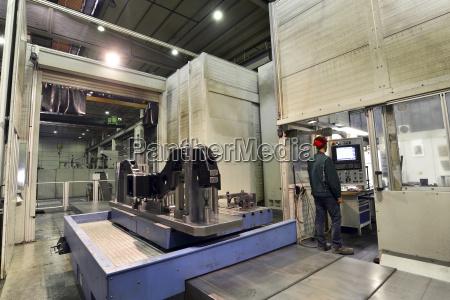 germany saxony workerworking at cnc machine