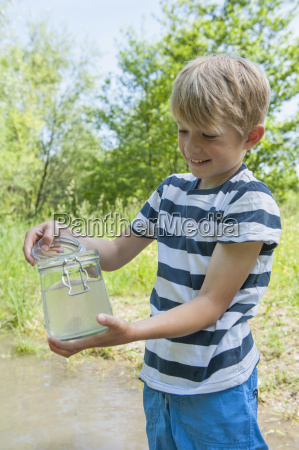 germany bavaria munich boy filling water