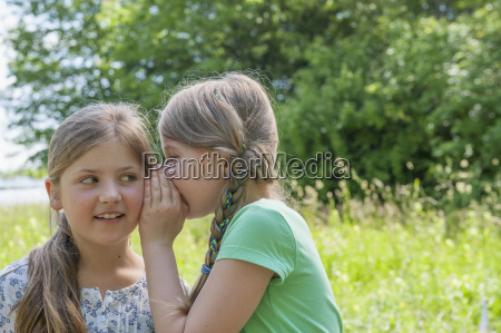 germany bavaria munich girl whispering in
