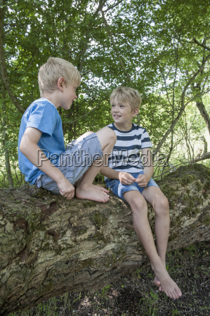 germany bavaria two boys sitting on