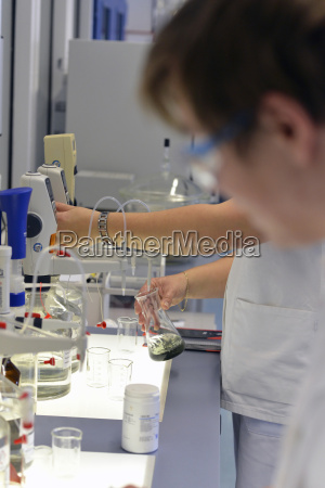 lab technicians examining products of a