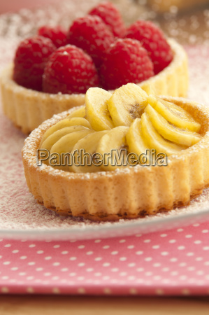 banana and raspberry tartlets on plate