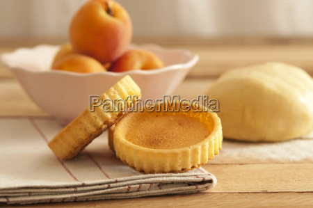 bowl of apricots with dough and