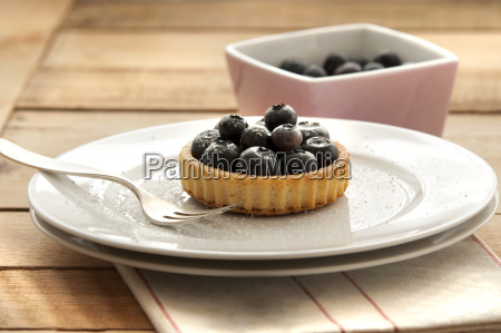 fruit tartlet with blueberries on plate