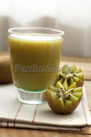 kiwi smoothie with fresh fruit on