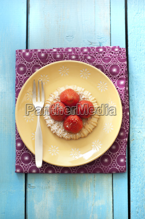 strawberry tartlet in plate close up