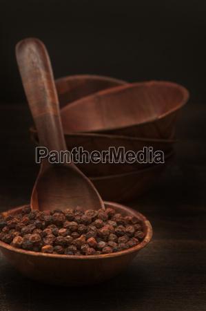 red pepper in bowl against black