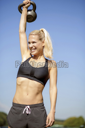 germany young athletic woman exercising with