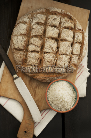 homemade rye bread with knife and