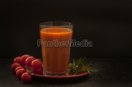 glass of tomato juice with cherry