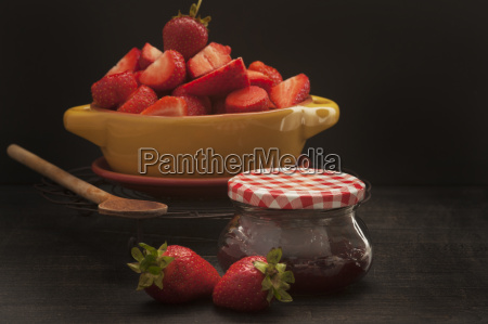bowl of strawberries with jam on