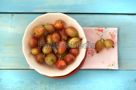 bowl of gooseberries on table with