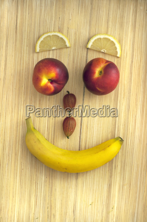 funny fruit face with banana gooseberries