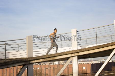 man jogging upwards a ramp