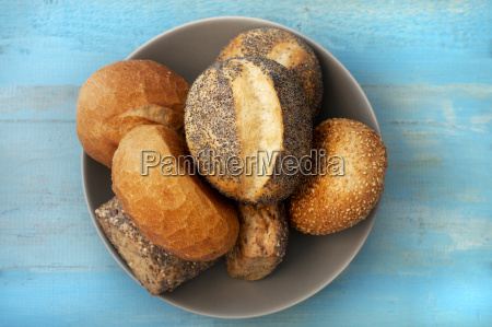 bowl of mixed rolls with poppy