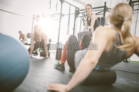 people in gym using foam roller
