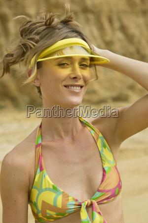 woman on beach bikini and visored