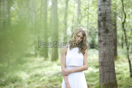 young woman wearing white dress in