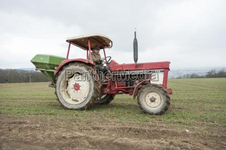 germany rhineland palatinate neuwied farmer sowing