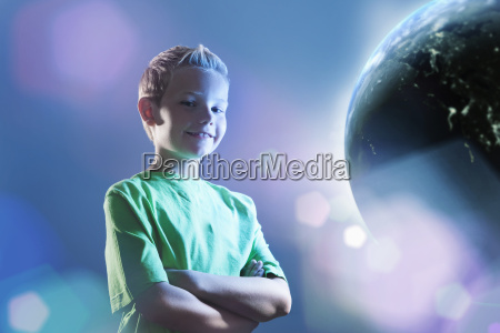smiling young boy watching earth