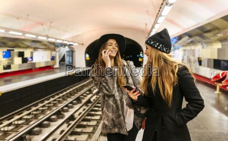 paris france laughing tourists waiting at