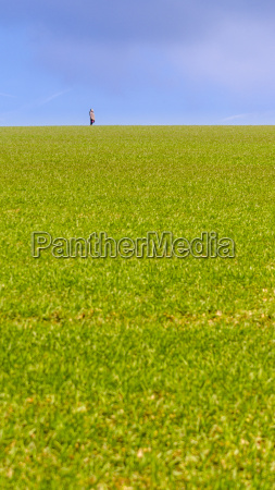 person far away on a meadow