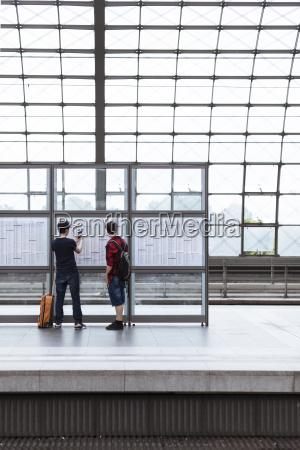 germany berlin two teenage boys looking