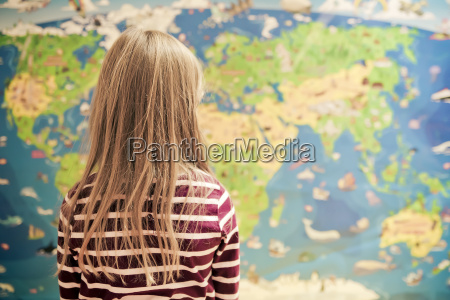 girl in front of world map