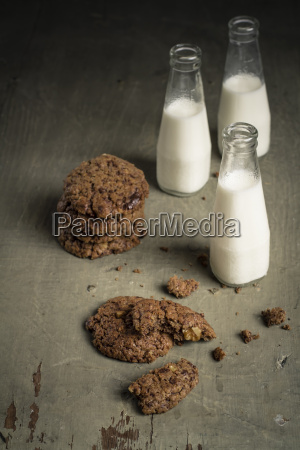 bottles of milk with chocolate cookies