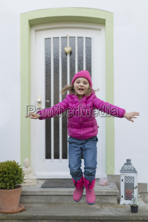 young girl wearing pink warm clothing