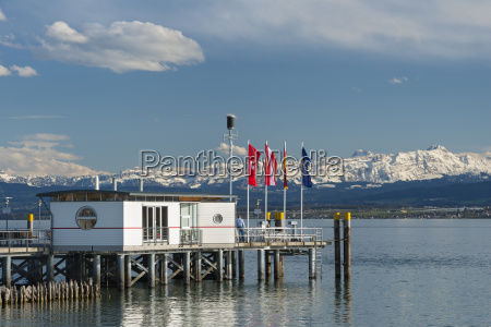 germany ferry jetty with flags and