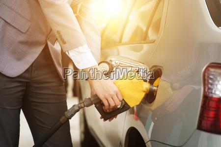 man pumping petrol